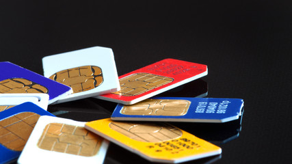 Colorful sim card on a black background
