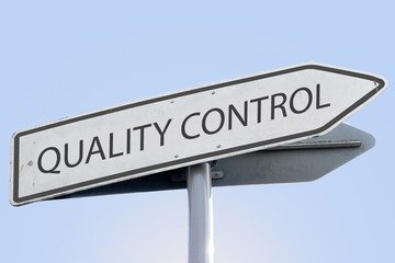 quality control words concept on road sign