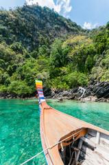 wood boat float in the coast sea