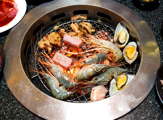 Barbeque seafood beef and pork grill with charcoal fire