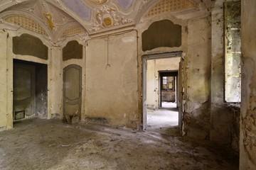 Old abandoned frescoed room in an italian villa.