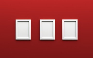Composition of three white blank photo frames on a red backgroun