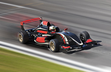 Wall Murals Motor sports F1 race car racing on a track with motion blur