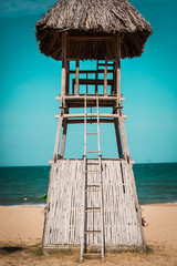 Vintage retro style filtered picture of a lifeguard tower on a b