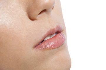 Close up Pink Lips of a Woman on White Background