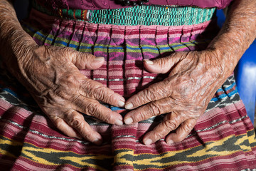 hands of an old mayan woman