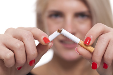 Close up Young Woman Breaking a Cigarette Stick