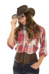 cowgirl red plaid shirt tilt head touch hat