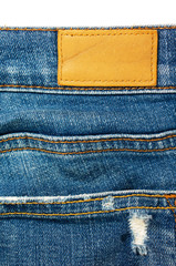 Closeup blue jeans with leather label