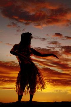 silhouette of Hawaiian woman grass skirt dancing