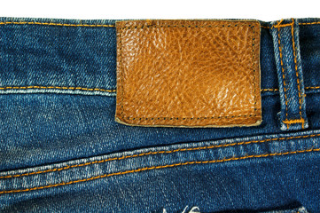 Brown leather label on blue jeans