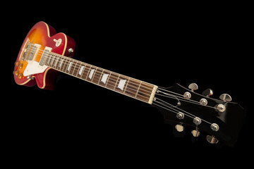 An electric guitar on a black background
