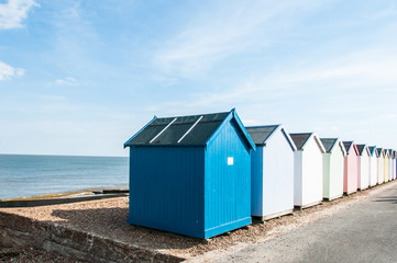 Colourful beach huts on a Suffolk  beach