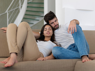 young couple making selfie together at home