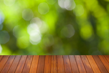 natural green bokeh background with wooden paving