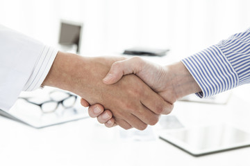 Physicians and women are shaking hands