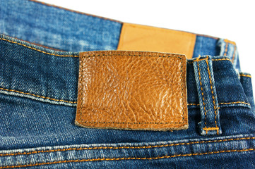Jeans closeup brown leather label