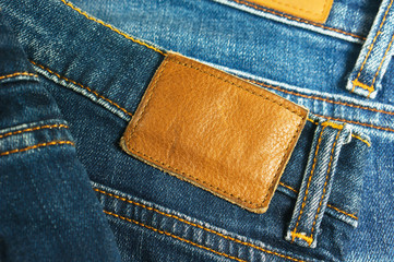Jeans with brown leather label closeup