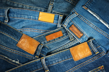 Jeans with brown leather labels background