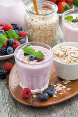 berry smoothie with oatmeal in a glass on table, vertical