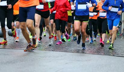 Athletes runs during the rainy Marathon