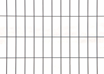 Wire mesh fence isolated on a white background .