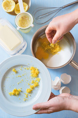 Adding in the Saucepan the Ingredients for Lemon Curd