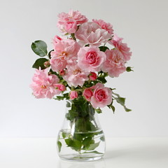 Bouquet of pink roses in a vase. Floral still life with roses.