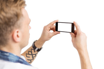 Young man taking photo with mobile phone