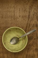Empty breakfast bowl with spoon