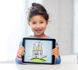 little girl showing castle on tablet pc screen