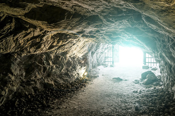 Bright light at the end of the caves in the Mountain Park of Rus