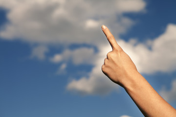 hand on a background sky