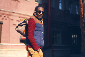 Outdoor fashion portrait of handsome stylish african man