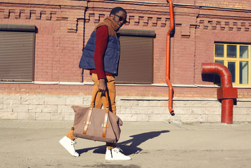 Wall Mural - Street fashion concept - handsome stylish african man