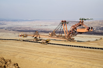 Giant mining excavator on the bottom surface mine.