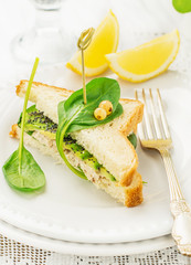 Appetizing sandwich with chicken, spinach, avocado and poppy