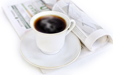 A cup of hot coffee and newspaper