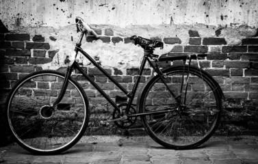 vintage old bicycle on brick wall