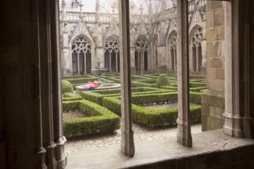 children near foutain in cathedral garden next to dom church in