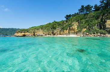 Tropical Beach paradise getaway lagoon with beautiful clear blue turquoise water and white sand, Okinawa