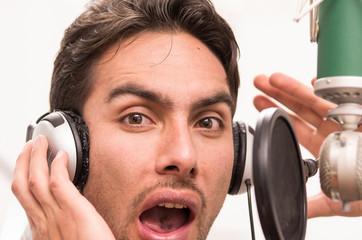 handsome man singing in music studio