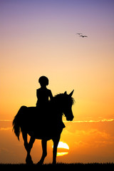 child on horseback