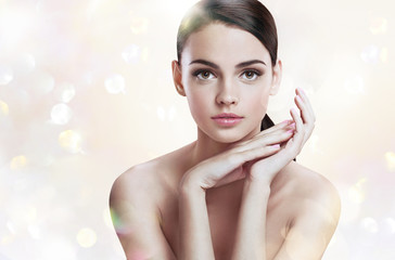 Charming young lady with perfect makeup, skin care concept