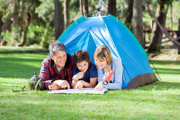 Family Reading Map At Campsite