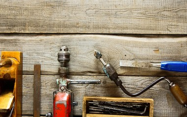 Various tools on a wooden background.