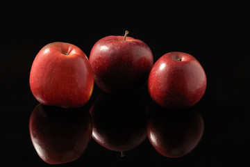 Red apples on a black background