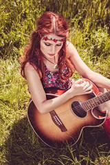Romantic beautiful girl with her guitar