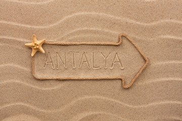 Arrow made of rope and starfish with the word Antalya on the san