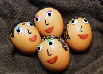 big eggs decorated with eyes and hair
